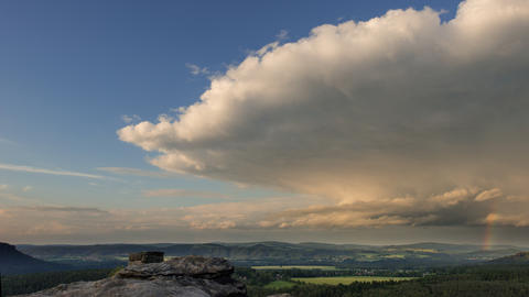 4k UHD huge cloud with rainbow time lapse 11410 Stock Video Footage