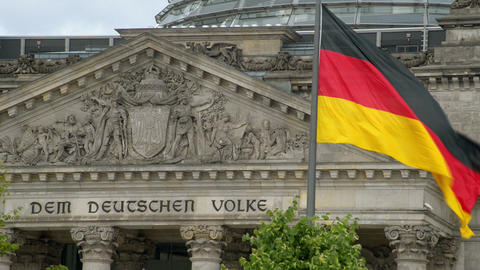 waving german flag in front of the bundestag 11412 Footage