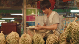 Vendor Preparing Durian For Sale At a Bangkok Frui Footage