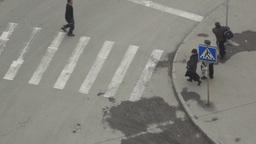 People crossing the street on a crosswalk Footage