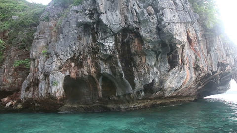 gray rock with caves in ocean Stock Video Footage
