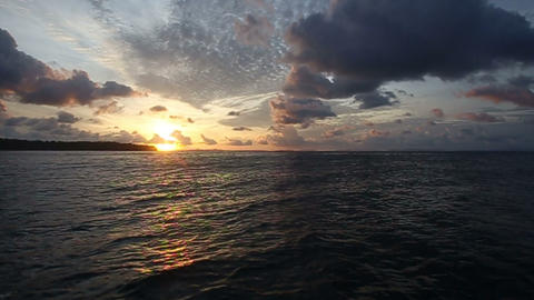 sunrise in the clouds in the ocean Stock Video Footage