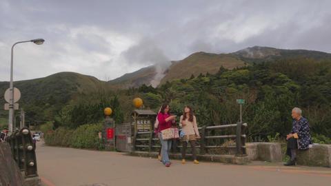 people walk at yanmingshan - great mountain backgr Stock Video Footage