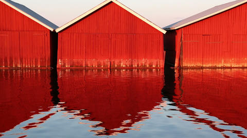 Red Wooden Boathouses At Lakeside stock footage