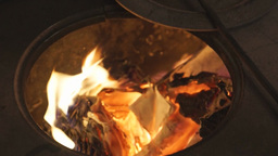 Man burns papers into the furnace Footage