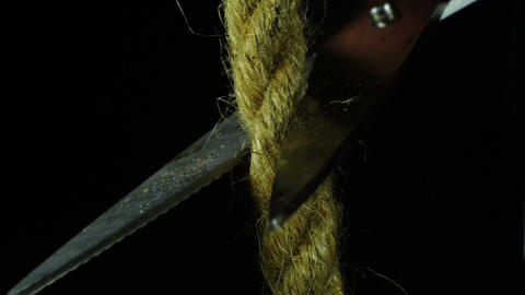 Cutting the rope with scissors Footage