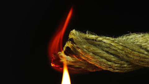 Set fire to rope - macro shot Footage