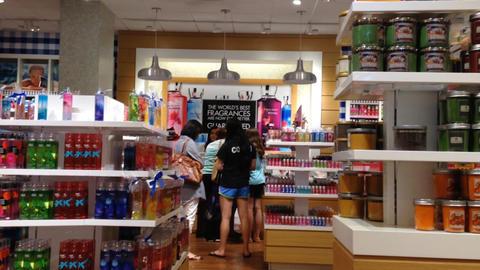 Woman choosing liquid scent on display shelf, Live Action