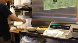 Staff packing leftover food for eat in customer Live Action