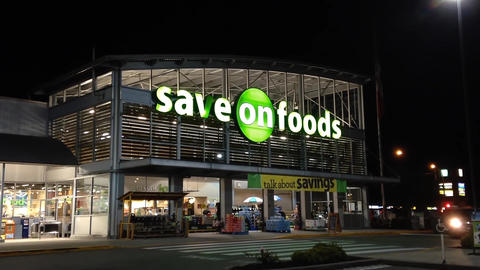 Save on foods at night scene Stock Video Footage