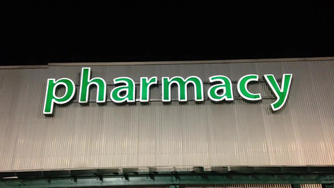 Pharmacy sign on building Stock Video Footage