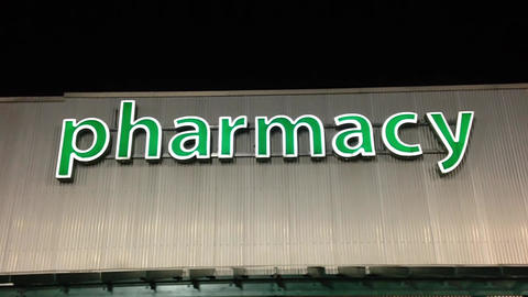 Pharmacy Sign On Building stock footage