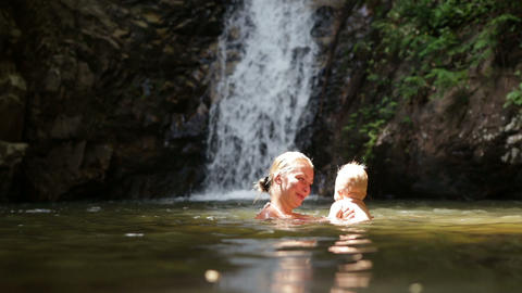 mom squirts baby waterfall Stock Video Footage