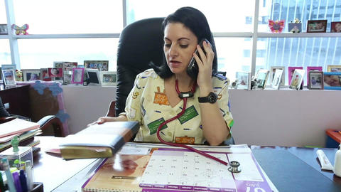 Female doctor with agenda and cellphone Stock Video Footage