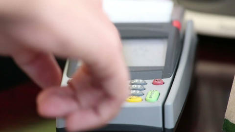 close up image of a credit card being swiped throu Footage