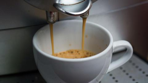 Coffee Machine Making Espresso into a Cap, closeup Footage