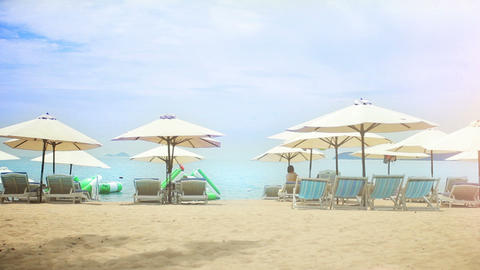 Sun umbrellas and chairs on a sandy beach Footage