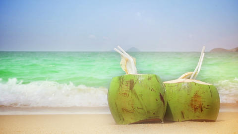 Closeup of two coconuts on a beach Stock Video Footage