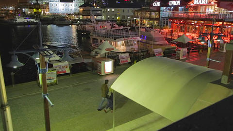 a evening birds eye view of a couple walking along Stock Video Footage