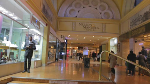 a pan in a section of sandton city mall behind nel Footage
