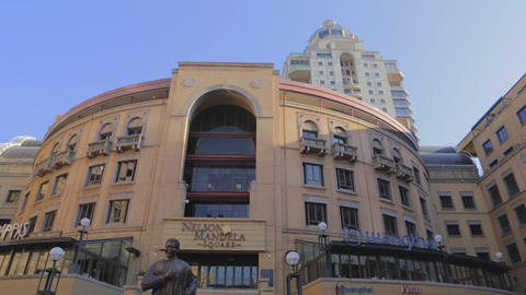 a high to low tilt of Sandton city its train stati Footage