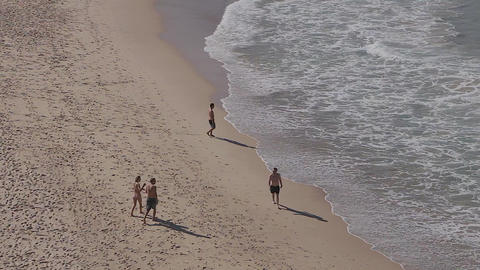 medium overhead of some people walking on bondi be Stock Video Footage