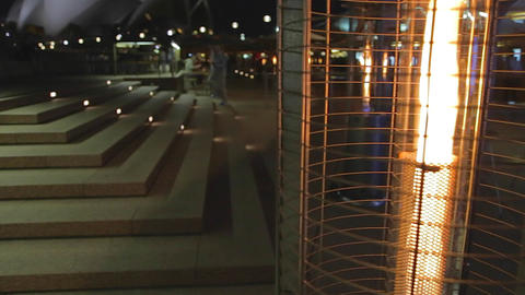 evening - pan from heat lamp patio to the Sydney o Footage