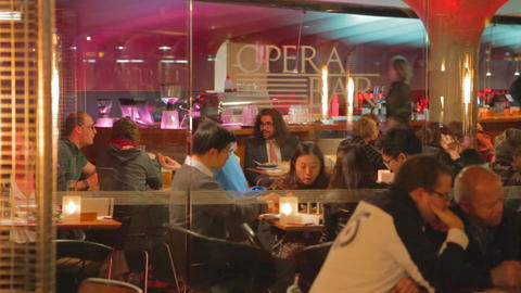 nightlife - people enjoying dinner and drinks at a Stock Video Footage