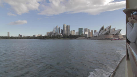 the ferry moves away from the Sydney CDB and opera Footage