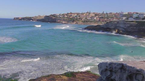 Pan Of Bronte Beach Ocean Surfers To The Beach stock footage