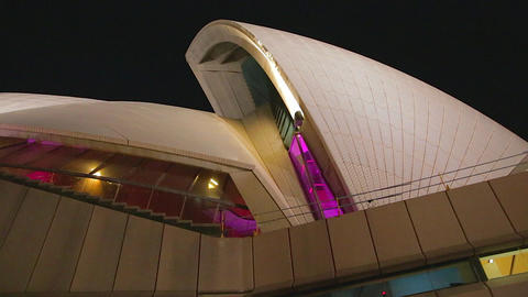 Pink glowing Sydney opera house in the evening 2 s Stock Video Footage