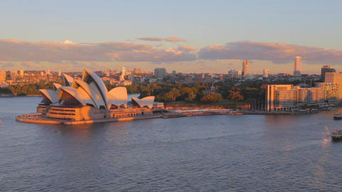 golden hour aerial - sunlight on the opera house Footage