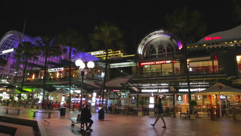 evening pan of the restaurants at darling harbour  Footage