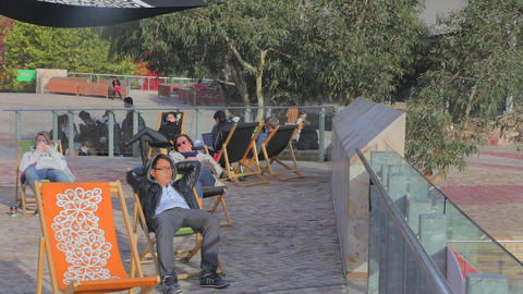3 angles - people napping on the federation square Stock Video Footage