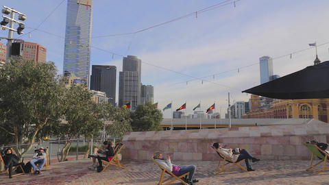 3 angles - people napping on the federation square Footage