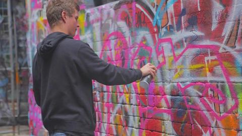 2 angles - close shot live graffiti street art at Stock Video Footage