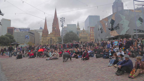 a pan of the crowd at federation square enjoying t Footage