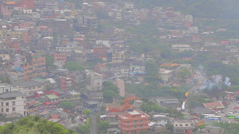 close aerial view of jiufen with fireworks Footage