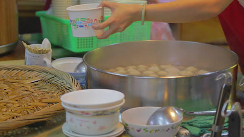 jiufen food stand serves meat ball Stock Video Footage