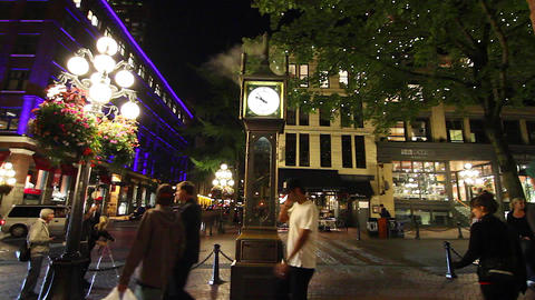 dolly shot - evening gastown clock - people Footage