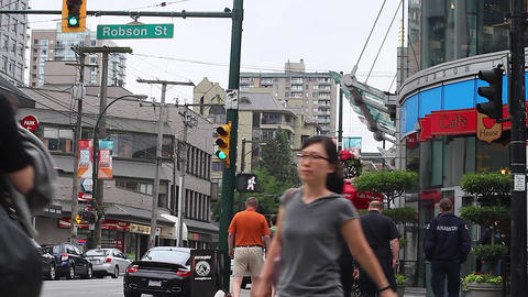 robson st - pedestrians cross Stock Video Footage