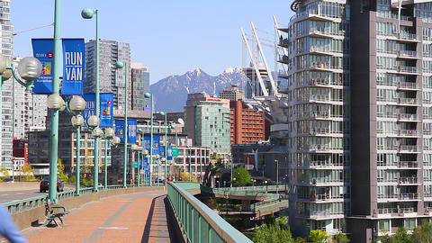 people cycling on cambie bridge - mountains Stock Video Footage
