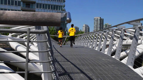 dolly shot -people walking olympic village 2 Stock Video Footage