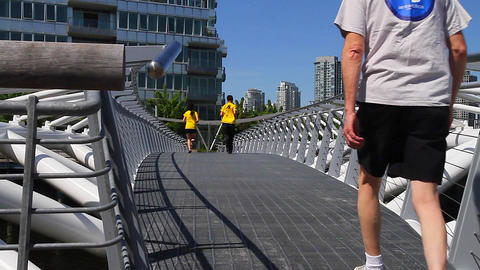 dolly shot -people walking olympic village 2 Footage