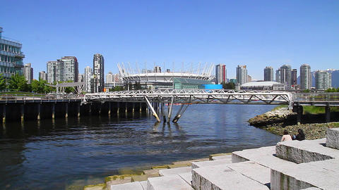 people relaxing at olympic village bc place Stock Video Footage