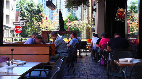 people on a yaletown patio Stock Video Footage