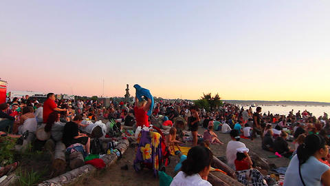 sunset english bay crowd waiting for fireworks sho Stock Video Footage