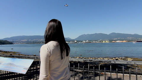 girl watches float plane from Stanley park Footage
