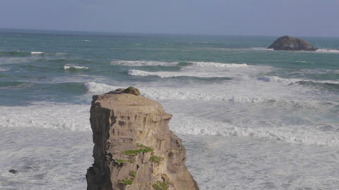 wide still shot of murawai ocean rock formation an Stock Video Footage