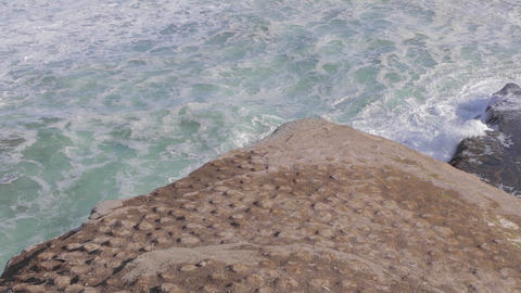 Overhead Tilt Shot From Ocean Rock Cliff To The Oc stock footage
